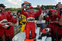 Race winner Ryan Briscoe celebrates