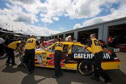 Caterpillar Toyota crew members push the car in the garage