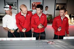 Rinaldo Capello, Alexandre Prémat, Mike Rockenfeller and Allan McNish play slot cars