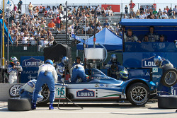 Pit stop for #15 Lowe's Fernandez Racing Acura ARX-01B Acura: Adrian Fernandez, Luis Diaz, while the left rear suspension is damaged