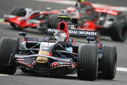 Sebastian Vettel, Scuderia Toro Rosso, STR02 leads Heikki Kovalainen, McLaren Mercedes, MP4-23