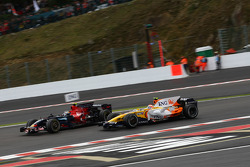 Sebastian Vettel, Scuderia Toro Rosso, STR02 and Nelson A. Piquet, Renault F1 Team, R28