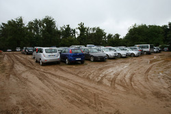 Media and Team car parks deluged with water and mud