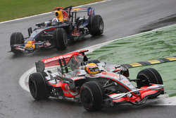 Lewis Hamilton, McLaren Mercedes, MP4-23 leads David Coulthard, Red Bull Racing, RB4