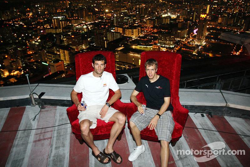 Mark Webber and Sebastian Vettel at the Heli Port of the Swiss Hotel