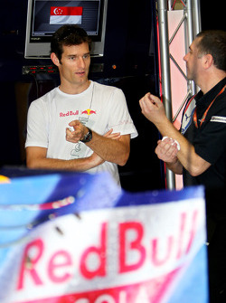 Mark Webber and a crew member