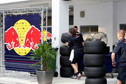 Neil Dickie and crew members with tyres in the paddock