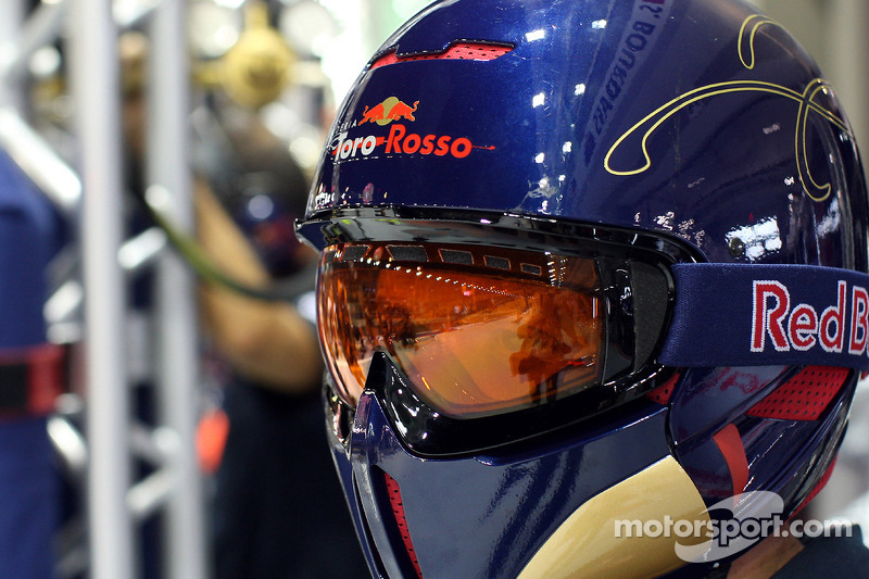 A Scuderia Toro Rosso crew member in the garage