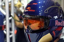 A Scuderia Toro Rosso crew member in the garage