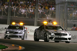 Safety car and medical car goes on track after Nelson A. Piquet, Renault F1 Team accident