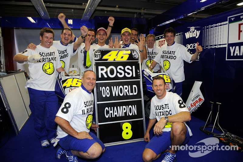 Valentino Rossi celebrates his 2008 world title with the team