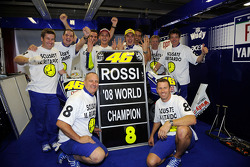 Race winner and 2008 World Champion Valentino Rossi celebrates with Yamaha team members