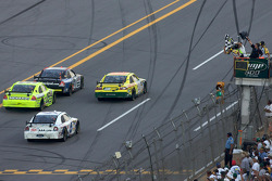 Tony Stewart takes the checkered flag ahead of Regan Smith, Paul Menard and David Ragan