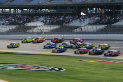 Bobby Labonte and Paul Menard lead a group of cars