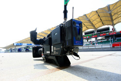 A TV camera sits on pit road