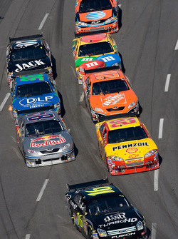 Greg Biffle leads a group of cars