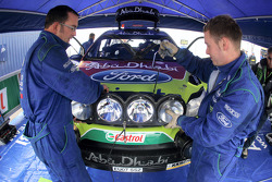 M-Sport technicians attach full lightpod to the Ford Focus RS WRC of Mikko Hirvonen and Jarmo Lehtinen