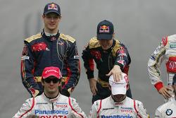 Sebastian Vettel, Scuderia Toro Rosso plays with the hat of Timo Glock, Toyota F1 Team