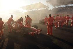 Felipe Massa and Kimi Raikkonen celebrate with burnouts