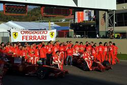Felipe Massa, Kimi Raikkonen, Marc Gene, Luca Badoer, Luca di Montezemolo, Piero Ferrari, Stefano Domenicali and Scuderia Ferrari team members celebrate 2008 Contructors World Championship