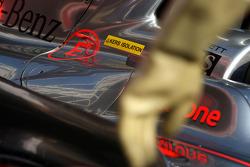 Gary Paffett, Test Driver, McLaren Mercedes, sticker for KERS and the rubber glove from a mechanic