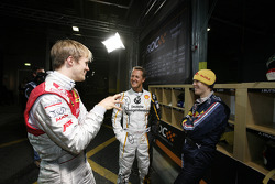 Mattias Ekström, Michael Schumacher and Sebastian Vettel share a laugh in the pits