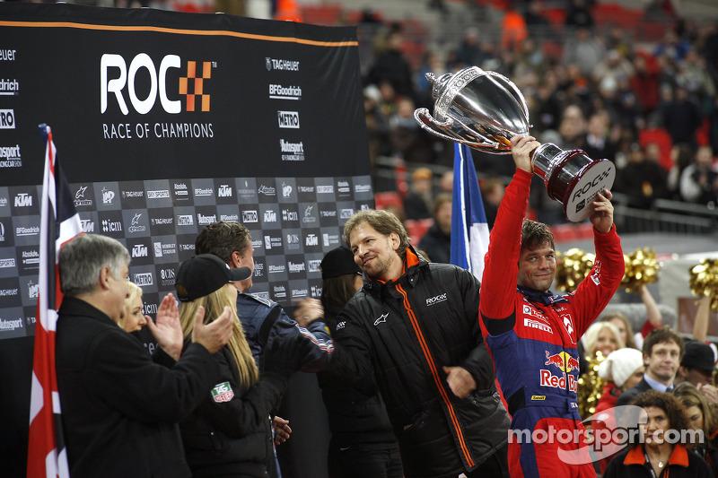 Podium: Race of Champions winner Sébastien Loeb lifts the winner's trophy