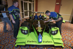 Patron Highcroft Racing team members remove the bodywork of the Acura ARX 02a Acura