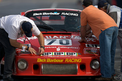 Porsche 935 K3 of Carlos de Quesada pushed on pit road