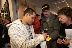 Juan Pablo Montoya signs autographs after the drivers meeting