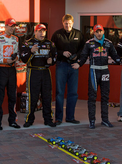 Raybestos Rookie of the Year radio-controlled car race event: Ryan Newman, Stewart-Haas Racing Chevrolet, Scott Speed, Red Bull Racing Team Toyota, and Joey Logano, Joe Gibbs Racing Toyota get ready for the start