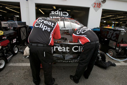 Crew members for Jason Leffler work on his car after a crash