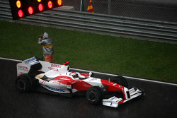 Jarno Trulli, Toyota Racing, on the reformed grid, after the race was red flagged due to rain
