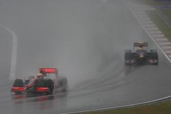 Lewis Hamilton, McLaren Mercedes and Sebastien Buemi, Scuderia Toro Rosso