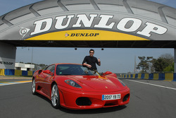 Patrick Dempsey poses with a Ferrari F430 GT