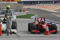 Jenson Button, Brawn GP and Kimi Raikkonen, Scuderia Ferrari