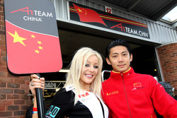 Grid girl and Congfu Cheng, driver of A1 Team China