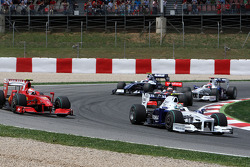 Nick Heidfeld, BMW Sauber F1 Team, Kimi Raikkonen, Scuderia Ferrari