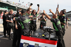 Panther Racing team members celebrate as Scott Sharp qualifies