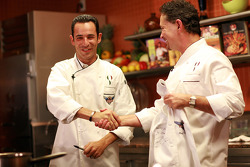 Indy 500 pole winner Helio Castroneves receives cooking lessons in Dallas: world-renown chef Stephan Pyles and Helio Castroneves share a laugh outside Stephan Pyles Resturant in Dallas, Texas