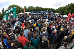 A massive crowd as Team Peugeot Total Peugeot 908 cars arrive at scrutineering