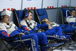 Team Peugeot Total team members take a nap between pit stops