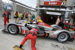 #1 Audi Sport Team Joest Audi R15 TDI: Allan McNish, Rinaldo Capello, Tom Kristensen pushed inside the garage