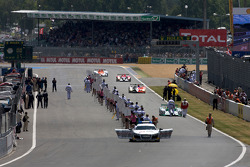 Cars arrive on the race starting grid