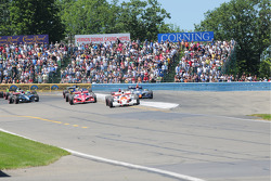 The field coming through turn 1 on lap 1