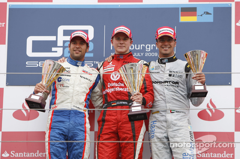 Nico Hulkenberg celebrates his victory on the podium with Roldan Rodriguez and Andreas Zuber