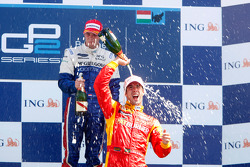 Giedo Van der Garde celebrates his victory on the podium with Lucas Di Grassi