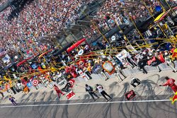 The pit crews show their drivers their pit boxes