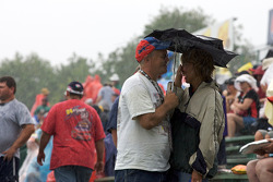 Fans take shelter from the rain