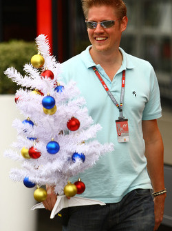 A man in the paddock with a Christmas tree